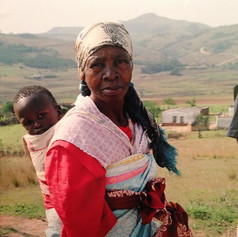 A grandmother looks after her orphaned grandchild. The parents died of AIDS.  Eswatini has one of the highest AIDS infection rates in the world.
