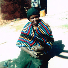 This hand knitted shawl sent by Africa Equip keeps this impoverished lady warm.