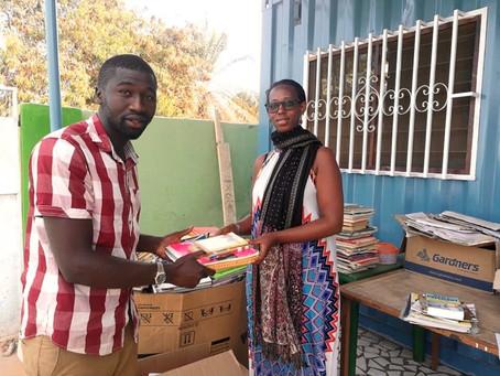 Jeanine Ngabonziza donates books to Gunjur Youth Movement