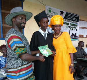 Faback Jibba with his proud mother receiving another of his prizes