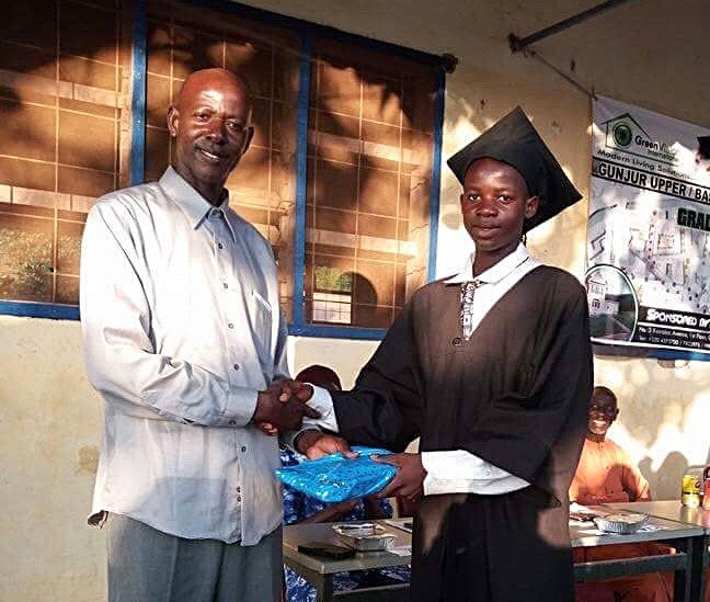 Faback Jibba receiving prize from Momodou Charreh Jibba