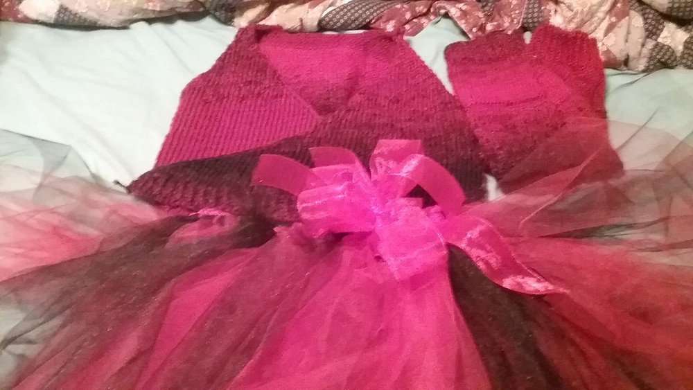 A pink knitted ballet outfit and tutu.