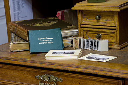 Books and postcards on desk