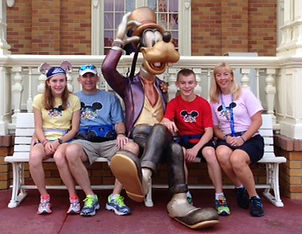 Photo of Drs. Graham and Martine Rose and their children at Walt Disney World.