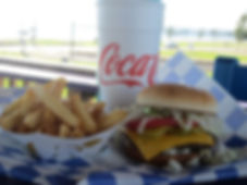 burger and fries on bench.jpg