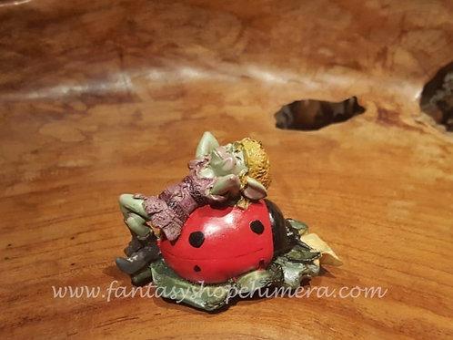 Pixie relaxing on ladybug
