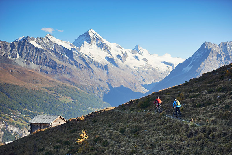 bicyclist, mountain bik, snow capped peaks
