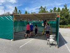 Students building the sukkah