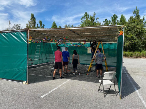 Students building the sukkah