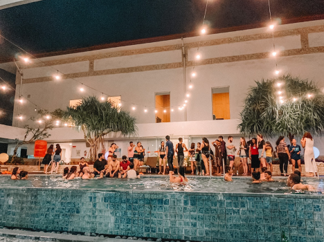 Participants at Jean-Pictet socialising and relaxing at the pool-side after a long-day of simulations and work. (Alicia Rose)