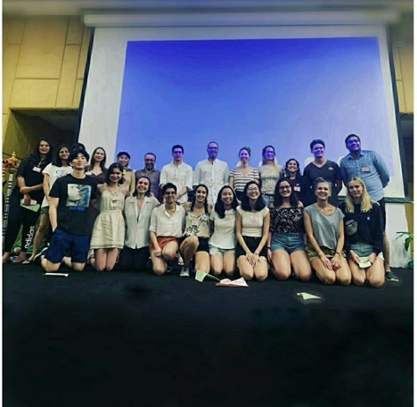 The UTokyo team along with the other red semifinalists: Belarusian State University, New York University, National University of Singapore, National University of Study and Research in Law Ranchi and Maastricht University. (Jean-Pictet Organizing Committee)