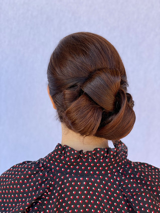 Polished and refined updo done at a tria