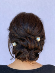 Modern updo with hairpiece.