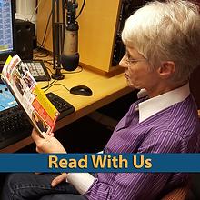 Volunteer Laraine reading in the studio