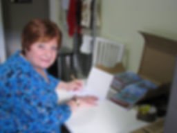 Author Siusaidh signing some of her books