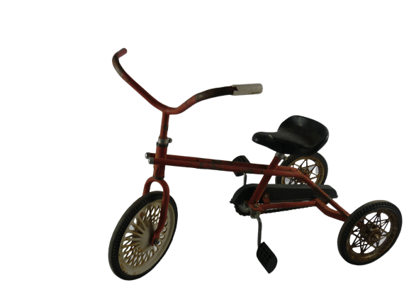 ancien petit tricycles rouge.