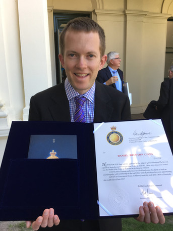 Daniel with his Order of Australia Certificate, Government House, Melbourne