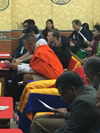Daniel sitting next to prime minister at International Conference on Autism and Neurodevelopmental Disorders, Thimphu, Bhutan