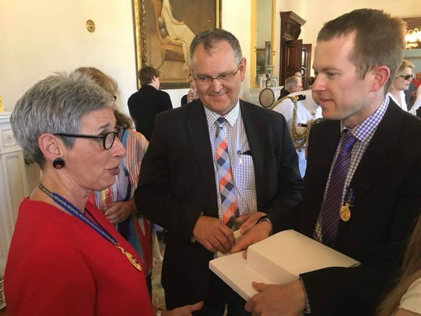 Daniel and Daryl speaking with Victorian State Governor, Linda Dessau when Daniel received his Order of Australia Certificate, Government House, Melbourne