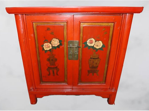 Handprinted red cabinet with flowers in vase with two doors