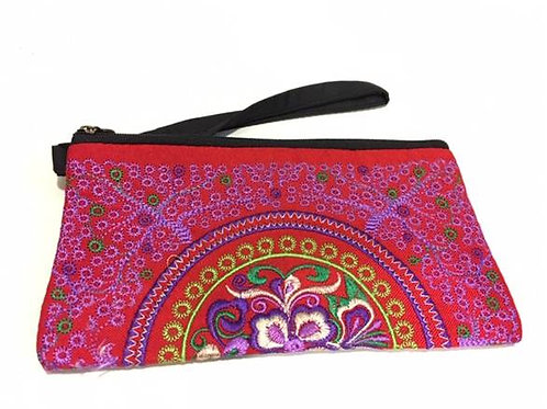 Red embroidered cotton bag adorned with purple flower