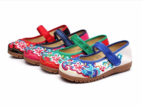 Embroidered shoe with strap and floral lotus pattern