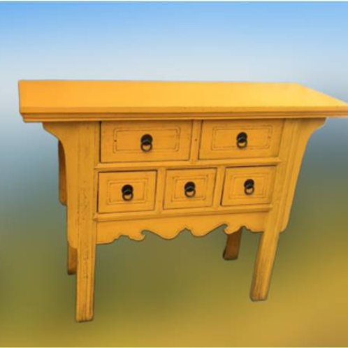 Long yellow table with five drawers