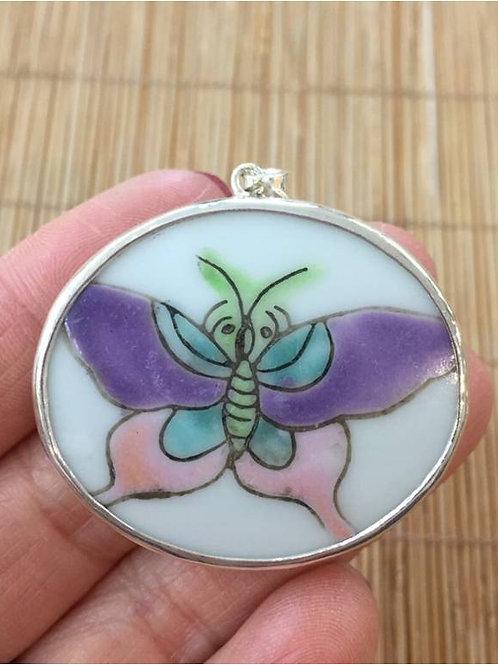 Fine porcelain butterfly pendant set in sterling silver