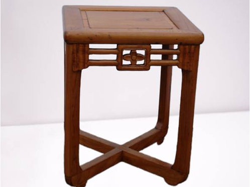 Elm stool with ornate carving