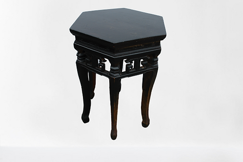 Hexagonal elm stool with ornate carving