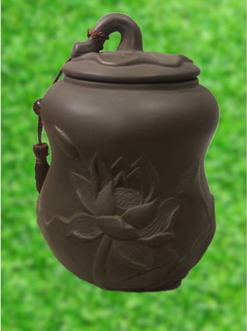 Porcelain Tea caddy made from purple clay with Lotus flower design