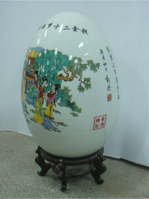 Eighty year old fine porcelain egg on stand