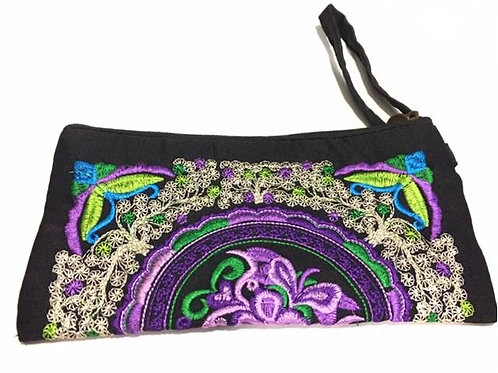 Black embroidered cotton bag adorned with purple flower