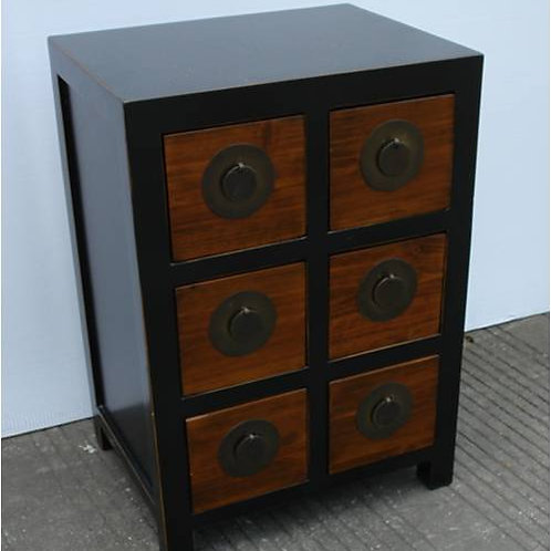 Six drawer cabinet decorated with copper handles