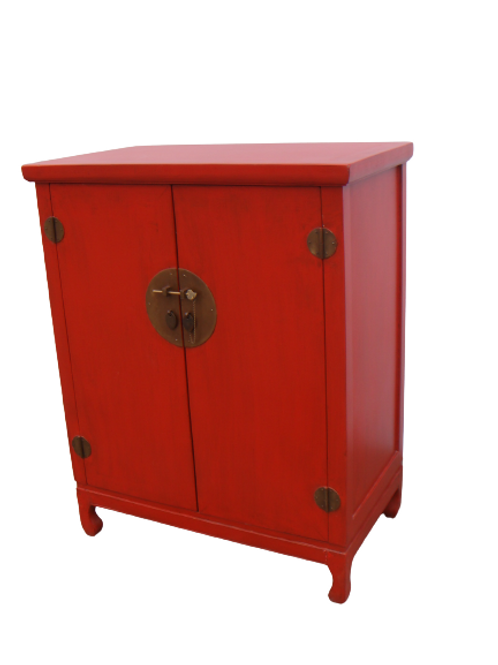 Red cabinet with two doors and copper handles