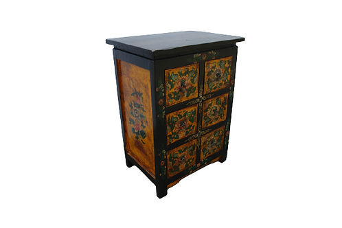 Ornately printed cabinet with flowers and copper handles