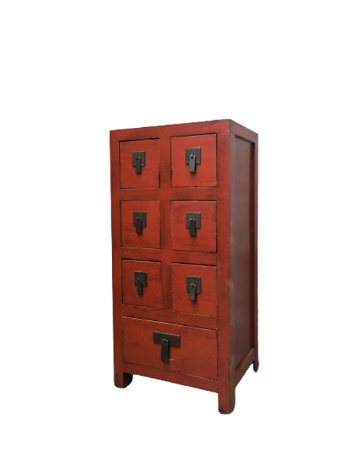 Red cabinet with seven drawers
