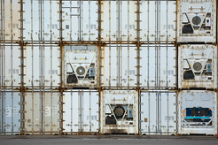 Stacked containers in a shipping termina