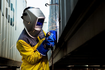 Industry worker with welding steel to re