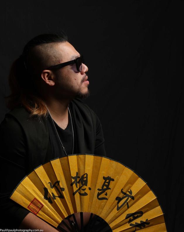 A man holding a fan