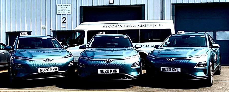 woodman taxis 3 blue cars.jpg
