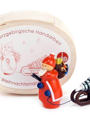 Weihnachtsmann mit Schlitten in Spandose