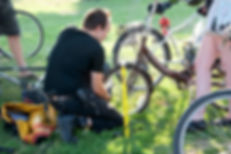 Geoff from Bike Pirates, doing some tune-ups in the park