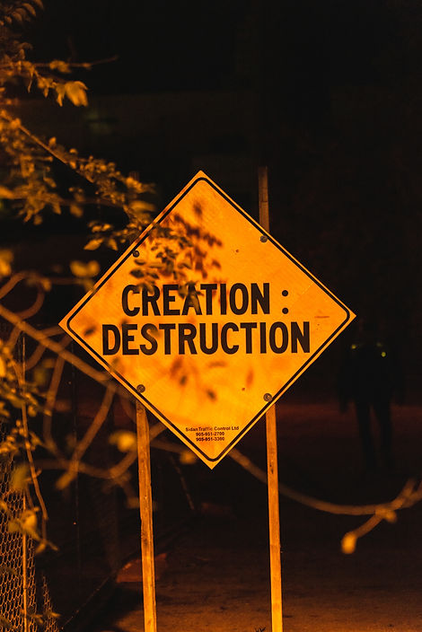 "A diamond-shaped orange construction sign that reads ""CREATION:DESTRUCTION"" from Nuit Blanche 2019."