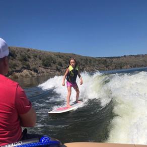 Teaching a kid to surf/waterski