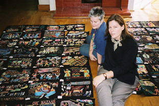 Gwen Miller and Wendy Ross designing layout of the wall panels