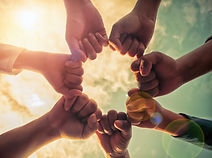 Hands together to represent partners