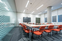 conference-room-interior-modern-office-with-white-walls-monitor.jpg