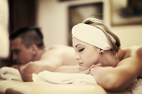 relaxed-young-couple-getting-massage-in-