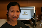 Carey College student in front of computer